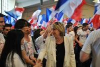Marie-Anne Montchamp en meeting avec Sarkozy
